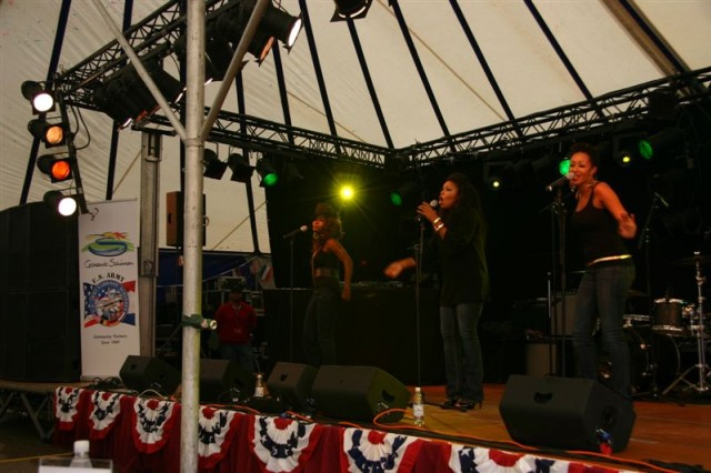 """Trin-I-Tee 5:7, a gospel singing trio sponsored by Army Entertainment, inspired USAG Schinnen 40th Anniversary celebration participants Sept. 19, 2009. The group is part of a larger Aca,!A""""Lift Up Your Spirits Tour 2009Aca,!A? to military bases."""