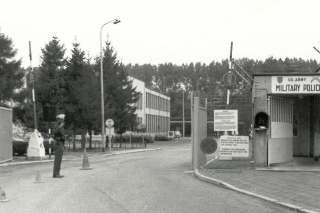 The old gate: In a photo taken around 1969, a Soldier waves someone into visit the headquarters of the U.S. Army Military Community, The Netherlands.