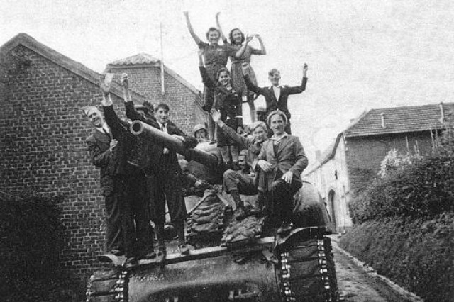 Driving down Dorpsstraat:  Scenes like this one in Oirsbeek, a town in the Municipality of Schinnen today, took place in Schinnen and Oirsbeek September 18, 1944 to welcome U.S. forces.