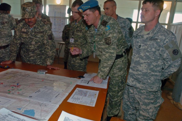 CAMP ILLISKY, Kazakhstan (Sept. 22, 2009) - (Pictured from right) Sgt. 1st Class Matthew Allen, Third Army/U.S. Army Central G3 Plans, listens as Col. Igor Batalygin, Kazakhstan head of the operations department for Air Mobile Forces, briefs Gen. Maj. Adilbek Aldaberpenov, Kazakhstan Air Mobile Forces Commander, on the status of operations during a tour of the Steppe Eagle information exchange at Camp Illisky, Kazakhstan, Sept. 22. Steppe Eagle is a part of Third Army's Theatre Security Cooperation program that is preparing coalition forces for full-spectrum operations.  (Photo by Sgt. Beth Lake, Third Army/USARCENT Public Affairs)
