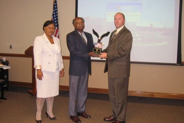 From left to right: Jean James, director of EEO at AMC; Roy Moody, EEO officer at the Army Sustainment Command; and Lane Collie, senior representative for AMC Forward. Collie presents an award to Moody during the annual AMC Equal Opportunity/ Equal Employment Opportunity roundtable in Huntsville, Ala. Sept. 15-17. U.S. Army Photo.