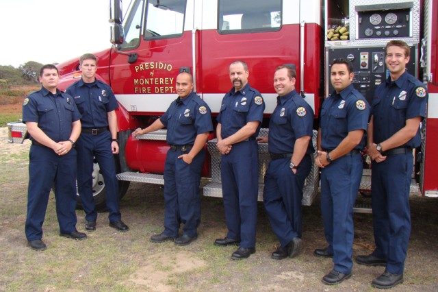 With the vehicle they used to fight the Los Angeles Station Fire are (from left) Presidio of Monterey Fire Department members Kythe R. Stillwell (check first name)  Joseph Almony, Chris Stephenson, Kennedy Santiago, Sean Hagerty, Efven Villa and Robert Farren. Not photographed: Shawn Benjamin and Frank Gonzalez.