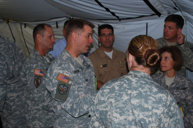 Col. Theodore Harrison, (left) commander, 410th Contracting Support Brigade discusses his brigade role in PANAMAX 09 with his boss, Brig. Gen. Camille M. Nichols, (far right) commander, Expeditionary Contracting Command.