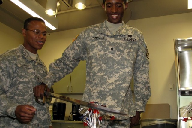 Sgt. First Class Ramon Quinones and Spec. Kenneth Simmons cut an Army birthday cake and celebrate World BLood Donor Day.  Monday, June 15, 2009 at the Robertson Blood Center on Fort Hood.