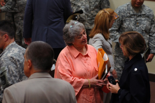 Guest speaker Sue McCloud, Mayor of Carmel-by-the-Sea, confers with Lt. Col. Donna O'Harren, USAF, after the DLIFLC Women's Equality Day Observance.