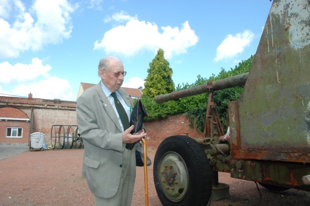 International Museum of ChiAfA..vres Air Base curator AndrAfA Neve shows off a British anti-aircraft cannon from World War II displayed in front of his museum.