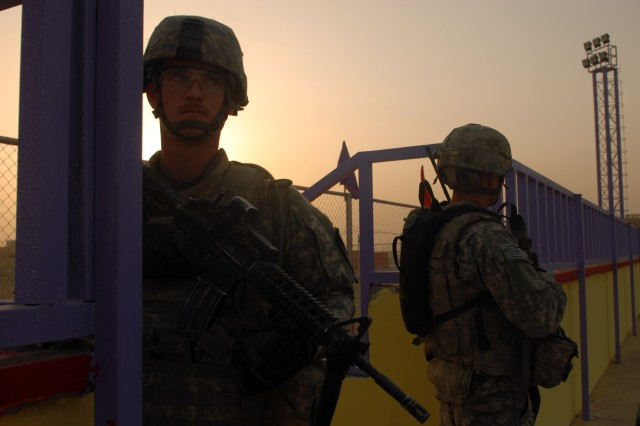 BAGHDAD - An early morning finds Pfc. James Freed (left) pulling security while on patrol in Sadr City, here, Sept. 18. Freed, a native of Odon, Ind., survived a sniper attack in June in which a bullet tore through his helmet, but only grazed his scalp.