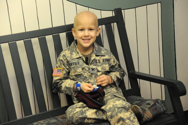 Evan sits on a bench at St. Jude's Children's Hospital in Memphis, Tenn., waiting for his Soldier friends to arrive.
