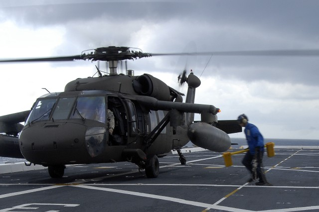 9/21/2009 - USS MESA VERDE, Gulf of Mexico - Air department chock and chainers race to secure an Army UH-60 Blackhawk helicopter, assigned to Joint Task Force-Bravo, to the flight deck during flight quarters aboard the amphibious dock transport ship USS Mesa Verde (LPD 19) Sept. 15. Mesa Verde is underway for Fuerzas Alidas (FA) PANAMAX 2009. FA PANAMAX is an annual U.S. Southern Command joint and multi-national training exercise tailored to the defense of the Panama Canal, involving civil and military forces from around the world. (U.S. Navy photo/Mass Communication Specialist 3rd Class Patrick Grieco).