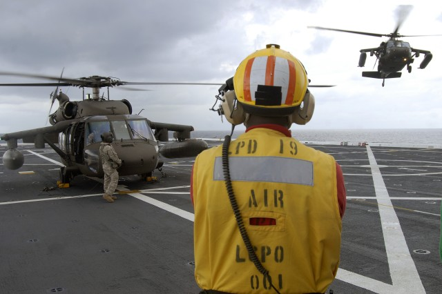 9/21/2009 - USS MESA VERDE, Gulf of Mexico - Another Army UH-60 Blackhawk helicopter, assigned with Joint Task Force-Bravo, prepares to land on the flight deck during flight quarters aboard the amphibious dock transport ship USS Mesa Verde (LPD 19) Sept. 15. Mesa Verde is underway for Fuerzas Alidas (FA) PANAMAX 2009. FA PANAMAX is an annual U.S. Southern Command joint and multi-national training exercise tailored to the defense of the Panama Canal, involving civil and military forces from around the world. (U.S. Navy photo/Mass Communication Specialist 3rd Class Patrick Grieco).