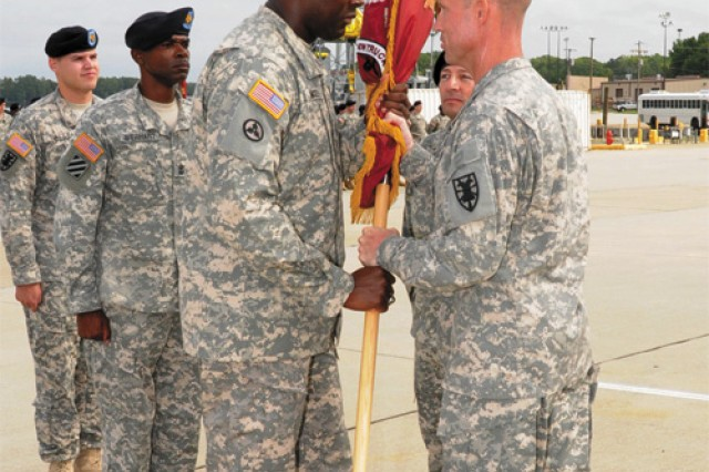 Command Sgt. Maj. Chris Mackey, incoming 6th Transportation Battalion command sergant major, accepts the unit colors from Lt. Col. Kevin Powers, 6th Trans. Bn. commander.