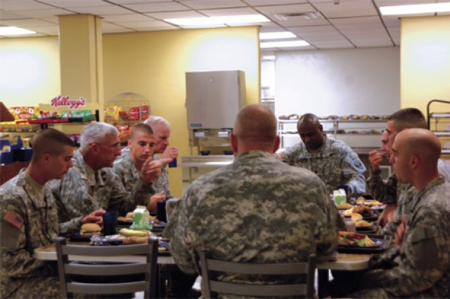 Maj. Gen. Mark P. Hertling, U.S. Army Training and Doctrine Command deputy commander, Initial Military Training lunches with Soldiers of C Company, 1/222nd Aviation Regiment at the 1/222nd Avn. Reg. dining facility at Fort Eustis Sept. 17. The luncheon was one of the items on the agenda for the DCG's daylong visit to Fort Eustis.