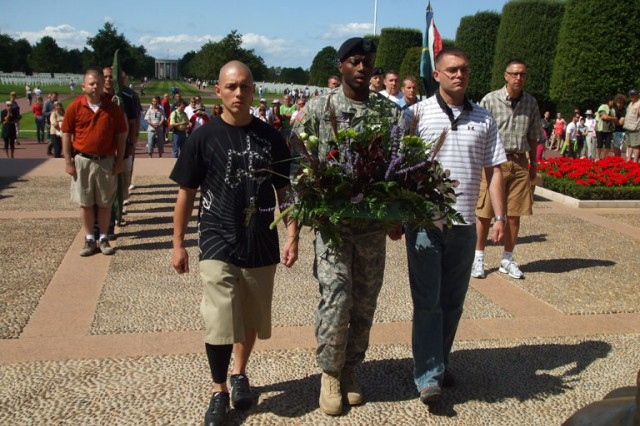 Left to right, Sgt. 1st Class Wilfredo Cabili, Sgt. 1st Class Charles L. Robinson III and Spc. Kenneth Kamrowski of Alpha Detachment, 1st Space Company (JTAGS-Europe) laid a wreath at the Normandy National Military Cemetery.