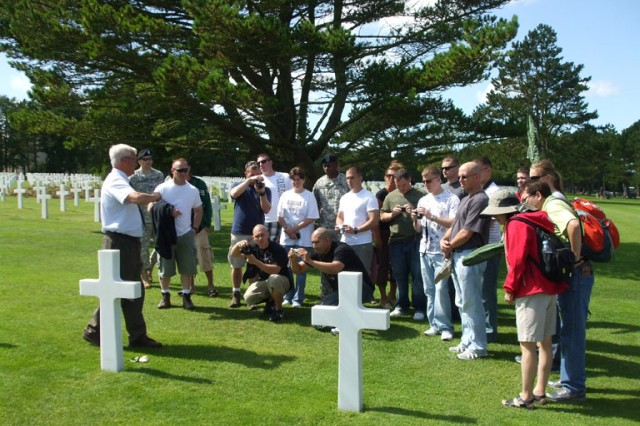 Command Sgt. Maj. (ret.) Dwight Anderson provides a history lesson to the Soldiers of Alpha Detachment, 1st Space Company (JTAGS-Europe) at the Normandy American Cemetery.