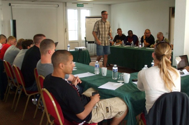 U.S. Army Space and Missile Defense Command/Army Forces Strategic Command Chaplain (MAJ) Kevin Pies teaches a Strong Bonds class to Alpha Detachment, 1st Space Company (JTAGS-Europe) at the Holiday Inn Conference Center in Caen, France.