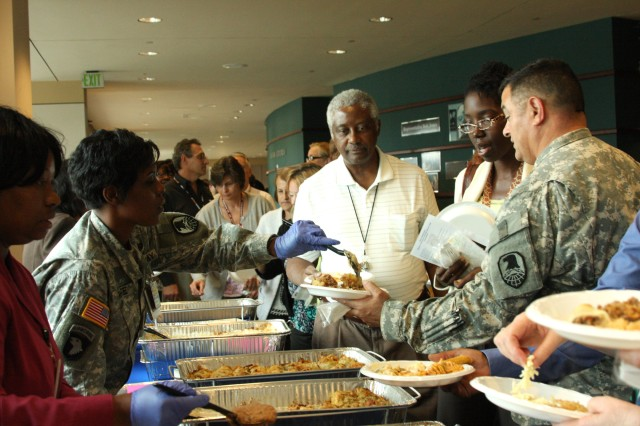 Master Sgt. Erika White serves Sgt. Maj. John Mattie during the Team Redstone Hispanic Heritage Observance that took place at Bob Jones auditorium Sept. 23. Mexican food samples were provided for the attendees. White and Mattie are both assigned to U.S. Army Space and Missile Defense Command/Army Forces Strategic Command. White is an equal opportunity advisor and Mattie is the G-3 sergeant major.