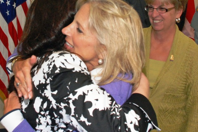Dr. Biden hugs spouse of deployed Soldier