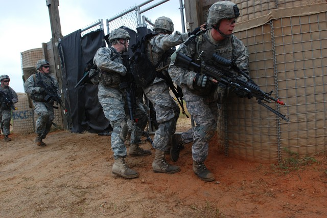 Paratroopers from Company B, 2nd Battalion, 325th Airborne Infantry Regiment, 2nd Brigade Combat Team, 82nd Airborne Division, breach a gate while assaulting an objective during combined arms live fire training at Fort Bragg, Sep. 17.