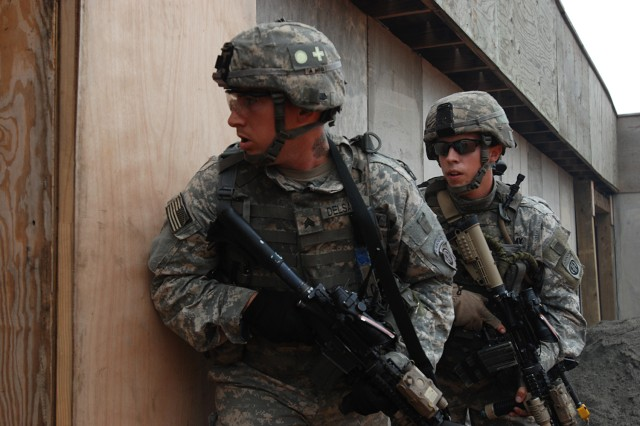 Sgt. Michael Del Sarto (right) and Pfc. Jacob Allen of Company B, 2nd Battalion, 325th Airborne Infantry Regiment, 2nd Brigade Combat Team, 82nd Airborne Division, prepare to enter and clear a room while assaulting an objective during combined arms live fire training at Fort Bragg, Sep. 17.