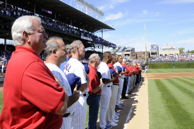 Medal of Honor recipients and Chicago Cubs players stand side by side for the singing of the Star Spangled Banner just before the Cubs and Brewers game at Wrigley Field on Sept 18, 2009.