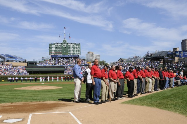 Medal of Honor recipients were recognized at Wrigley Field before the Cubs and Brewers game on Sept 18. Service members presented the American flag on the field.