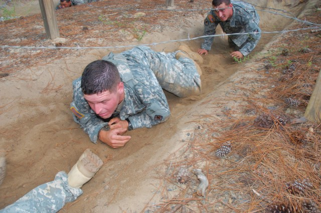 Sgt. Matthew Vitug, with the 17th Military Police Detachment, navigates the Fit to Win course during a tryout for the Special Reaction Team Sept. 14. Vitug was one of eight Soldiers trying out for two spots on the elite team.