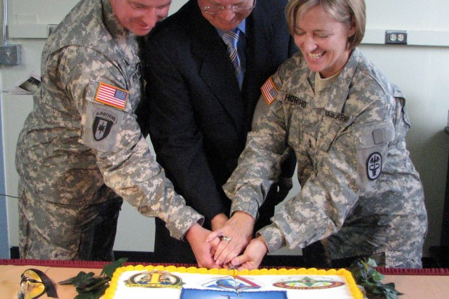 Col. Jerry Penner III, commander of Madigan Army Medical Center, Dr. John Meyer, director of Madigan's Health Outcomes Management and Maj. Gen. Patricia D. Horoho, commanding general of the Western Regional Medical Command, cut the cake dedicating the new name and innovative improvements to the Soldier Evaluation for Life Fitness program Sept. 14 at Madigan Army Medical Center Annex. The SELF initiative further strengthens the Army's commitment to provide top behavioral health services to its redeploying Soldiers.