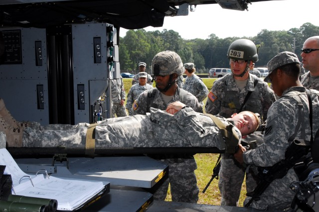 Sergeants Andrew Dishman and Timothy Whitlock, 3/15 Inf., 4th IBCT, practice loading and unloading a 'casualty' onto a Blackhawk during an EFMC validation training exercise at the Fort Stewart Confidence Obstacle Course, Sept. 10.