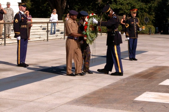 Public affairs personnel from the Kenyan Army dedicate and lay a wreath at the Tomb of the Unknown Soldier in Washington, Sept. 15. The Kenyan Army was invited as a part of a public affairs exchange between Third Army / U.S. Army Central and Kenyan public affairs personnel. The purpose of the visit was to compare public affairs strategies between United States and Kenya militaries and improve interoperability and cooperation between the partner nations. The Kenyan personnel also visited with the Office of the Chief of Public Affairs at the Pentagon to discuss different media relation strategies.