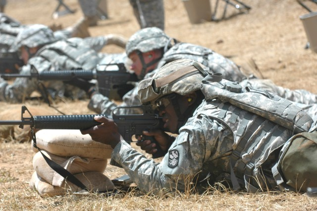 SCHOFIELD BARRACKS, Hawaii -- Soldiers from the 94th Army Air and Missile Defense Command fire the M16A2 rifle from the prone, unsupported position at a range here during the command\'s Range Week September 7-11, 2009.