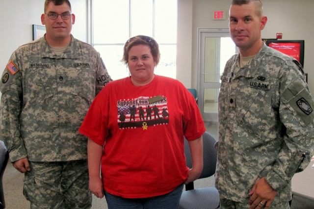 """Staff Sgt. Michael Massimino, Community Life Non-commissioned officer; Kerry Rodriguez, McNair Village Mayor; Lt. Col. Chad Skaggs, 2-1 ADA at the Robertson Blood Center on Fort Hood at the culmination of an Armed Services Blood Drive. September 18, 2009. """""""