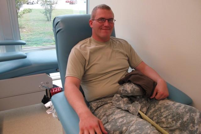 "Spc. Bradley Altom, and Avenger Crewmember, donates blood at the Robertson Blood Center at Fort Hood, Texas on September 18, 2009."""