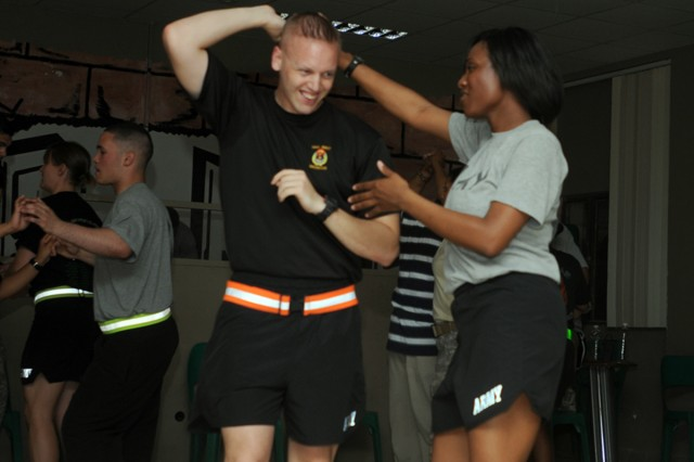 CONTINGENCY OPERATING BASE SPEICHER, TIKRIT, Iraq - Sgt. James Whorley, 23, of Sacramento, Calif., an imagery analyst from Headquarters and Headquarters Company, 3rd Infantry Brigade Combat Team, 25th Infantry Division, dances at the Morale, Welfare and Recreation center's Friday Salsa night. Whorley uses the event as a way to defeat stress and stay motivated during his deployment to the Salah ad-Din province in Iraq.