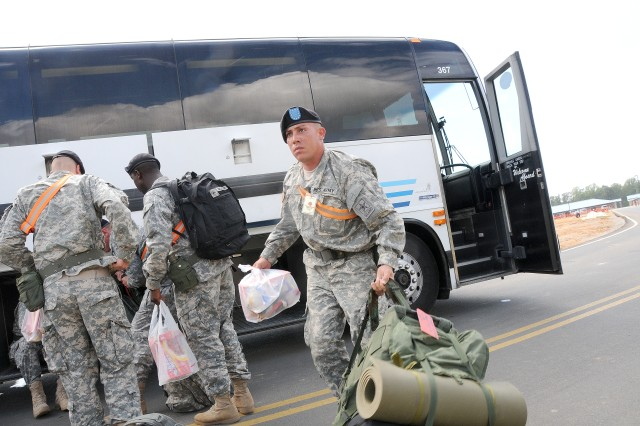 The Ordnance School operations at Aberdeen Proving Ground, Md. are beginning to wind down as construction at the school's new location at Fort Lee continues at a rapid pace. However, neither has stopped the institution from fulfilling its mission to train ordnance Soldiers. The Ordnance School transported the first wave of more than 500 ordnance advanced individual training Soldiers here Sept. 23 to begin training at the school's $700 million campus. Photo by T. Anthony Bell