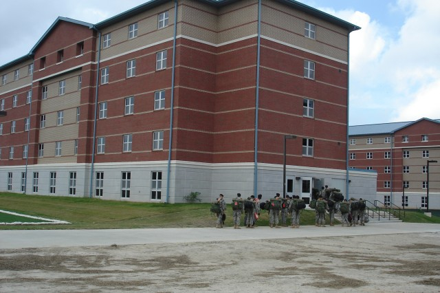 A group of Soldiers make their way into the newly constructed barracks. On Sept. 23, more than 500 ordnance Soldiers arrived at Fort Lee, Va. -- the first wave of advanced individual training Soldiers to begin training at the Ordnance School's $700 million campus. The Ordnance School will train more than 3,000 Soldiers annually in more than 30 military occupational specialties at Fort Lee. Photo by Albert Cruz, BRAC Construction Office program manager