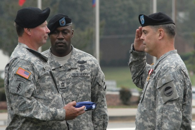 "Gen. Charles C. Campbell (left), commander of U.S. Army Forces Command, presents Maj. Gen. John A. Yingling, outgoing FORSCOM Deputy Chief of Staff, G3/5/7, with a U.S. flag as part of Yingling's retirement ceremony Sept. 18 in front of FORSCOM headquarters at Fort McPherson, Ga.  In his speech during the ceremony, Campbell thanked Yingling for his 35 years of service and told him that he left the Army ""respected, admired, and valued as a comrade who always shouldered more that his fair share of the load."" (U.S. Army Photo)"