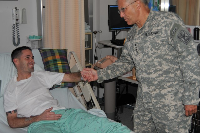 Petty Officer 2nd Class Christian L. Dullock-Binoche meets Chief of Staff of the Army Gen. George W. Casey Jr. at Landstuhl Regional Medical Center, Germany, on Sept. 25, 2009. Dullock-Binoche is being treated at Landstuhl Regional Medical Center for an illness that occurred while deployed to Kuwait.