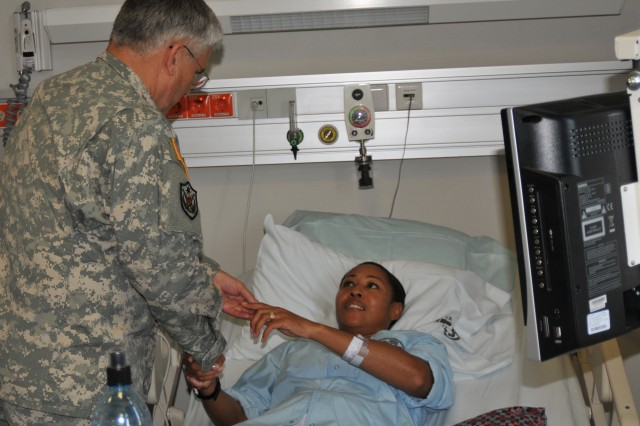 Sgt. 1st Class Cassandra Y. Snow meets Chief of Staff of the Army Gen. George W. Casey Jr. at Landstuhl Regional Medical Center, Germany, on Sept. 25, 2009. Snow is being treated at Landstuhl Regional Medical Center for an illness that occurred while deployed to Iraq.