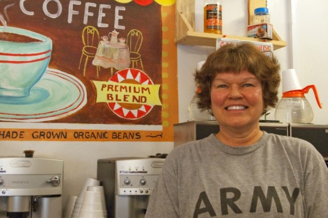 """Sgt. Maj. Virginia Stickler, a Half Moon Bay, Calif., native and a member of the 287th Sustainment Brigade, is the manager of God's Grounds, a coffee shop at Contingency Operating Base Adder that supplies coffee, snacks and, for some Soldiers, advice. """"A number of Soldiers come here and they're stressed and they're away from their families, away from their support systems, and they come here to kind of talk and ventilate, and I'm able to listen,"""" said Stickler, who has a background in counseling."""