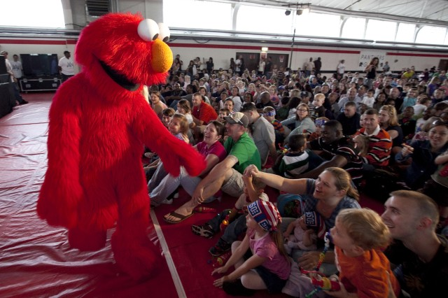 Elmo greets some of his fans in the audience during a performance of the Sesame Street/USO Experience for Military Families at U.S. Army Kaiserslautern Sept. 20. The Sesame Street tour also stopped in Mannheim, Heidelberg and other locations throughout Europe. The free show was designed to educate military families about how to help children cope with the challenges of deployment.