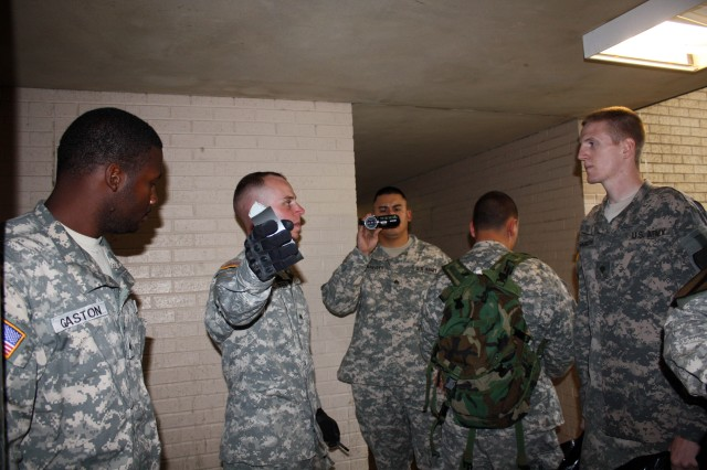 """Sgt. Jesse Schuster, a team leader assigned to the 2nd Battalion, 12th Cavalry Regiment, 4th Brigade Combat Team, 1st Cavalry Division """"Long Knives,"""" of Blacksburg, Va., briefs his team prior to entering an abandoned build Sept. 22.  The Soldiers participated in a three-day tactical site-exploitation exercise at Fort Hood, Texas by a mobile training team of civilian instructors."""