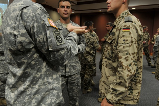 Two 82nd Airborne Division Paratroopers chat with a German soldier during a social event on 28 September 2009 to introduce Paratroopers participating in Operation Bright Star. Troopers from Egypt, Germany, Pakistan and Kuwait arrived to Fort Bragg to kick off the first half of the operation. On 12 October, U.S. troopers will travel to Egypt to complete it.