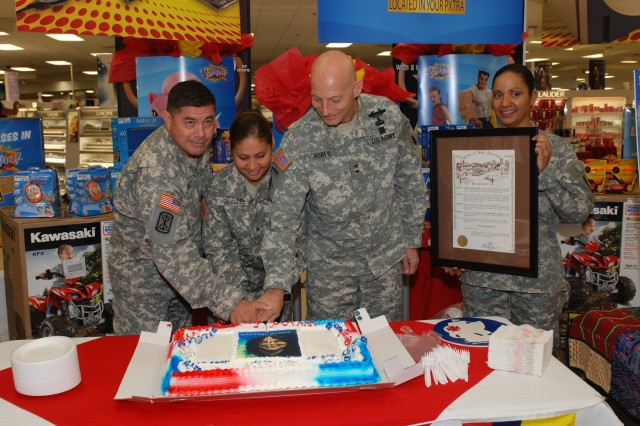 During this year's Hispanic Heritage Month celebrations (left to right) Command Sgt. Maj.  Armando Ramirez, Army South command sergeant major; Sgt. Esmeralda Hernandez, Special Troops Battalion; Maj. Gen. Keith M. Huber, Army South commander; and Sgt. 1st Class Mina Vargas, 470th Military Intelligence initiate the celebrations with a cake-cutting ceremony at Fort Sam Houston, Texas, Sept. 15.