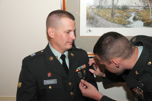 Spc. Shiloh Becher, representing U.S. Army Reserve Command, receives some last minute adjustments before appearing before the board of six command sergeants major and the Sgt. Maj. of the Army on Sept. 28, during the 2009 Department of the Army Best Warrior Competition at Fort Lee, Va.