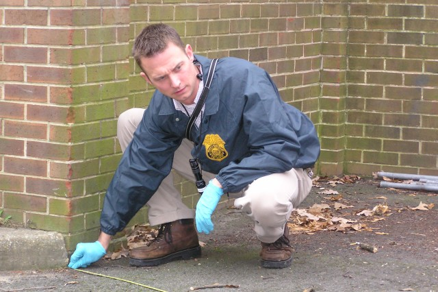A U.S. Army Criminal Investigation Command special agent processes a crime scene on an Army installation. Thirty new sexual-assault investigators will be assigned to various major Army installations worldwide to assume the lead in forming special victim investigative units in support of the Army's Sexual Harassment/Assault Prevention and Response Program known as SHARP.