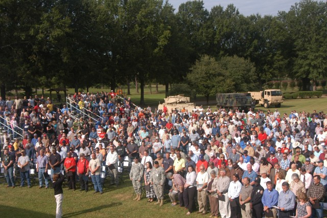 Honorees are shown in the center of Red River Army Depot's parade field during the Global War on Terrorism awards ceremony on Sept. 1. The ceremony honored civilians who have directly supported the armed forces in Iraq and Afghanistan. (U.S. Army photo by Danny Feagin)