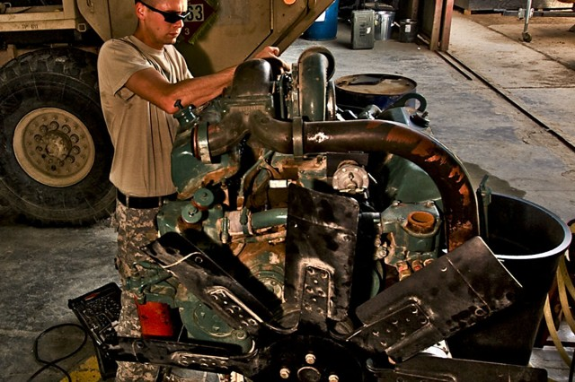 CAMP TAJI, Iraq-To ensure the injectors are adjusted correctly on a new engine, Spc. Lee Benjamin, from Batson, Texas, a light wheeled vehicle mechanic in Company E, 4th Battalion, 227th Aviation Regiment, 1st Air Cavalry Brigade, 1st Cavalry Division, checks the adjustment of the injectors on the old engine, here, Sept 28.