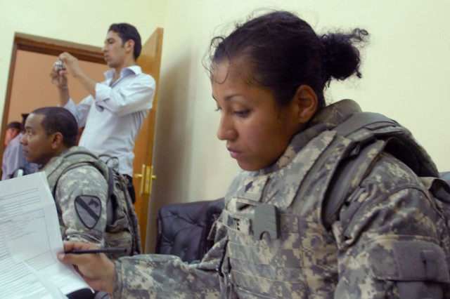 "TAJI, Iraq- Camden, N.J. native, Spc. Sesily Aponte, a civil affairs team member attached to 1st Battalion, 82nd Field Artillery Regiment, takes notes on the services offered at the medical facility that is in the heart of Taji Market, Sept. 27. The clinic supports Taji and immediate areas as the primary medical facility. ""The clinic was better than I expected it to be. It seemed to be successful and doing well,"" said Aponte."