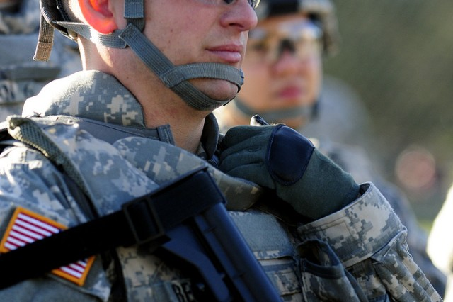Spc. Shiloh Becher, the Army Reserve Soldier of the Year, listens to instructions during reflexive fire training the Department of the Army Best Warrior Competition at Fort Lee, Va. on Tuesday, Sept. 29, 2009.