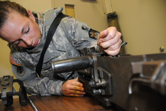 Sgt. Sarah Haskins, Space and Missile Defense Command/Army Forces Strategic Command, disassembles a .50 caliber machine gun. Haskins is one of 24 Soldiers competing in the Army's Best Warrior Competition being held at Fort Lee, Va.